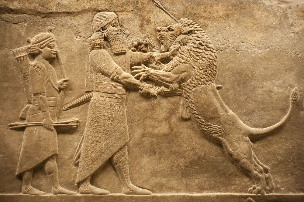 5710593 - old relief representing an assirian warrior hunting lions
