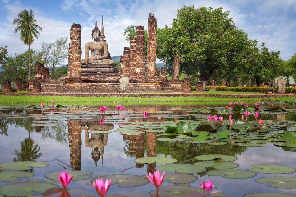42199215 - buddha statue at wat mahathat in sukhothai historical park,thailand